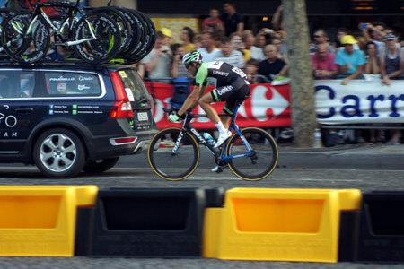 Paris,France, July 21nd 2013:  Le Tour de France 2013. Cyclist riding  on Avenue des Champs Elysees in Paris.