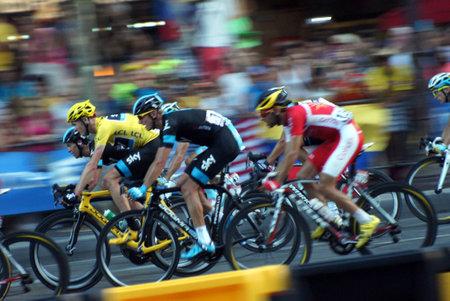 Paris,France, July 21nd 2013:  Le Tour de France 2013. The peloton with Christopher FROOME  riding on Avenue des Champs Elysees in Paris.