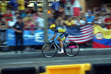 champs elysees: Paris,France, July 21nd 2013   Le Tour de France 2013  Cyclist HERNANDEZ riding  on Avenue des Champs Elysees in Paris  Editorial