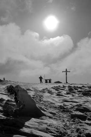 The cross on top of the mountain in winter, Poland photo