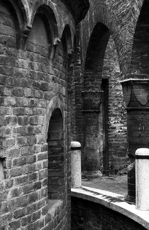 backstreet: black and white medieval backstreet in Mantua,  Italy