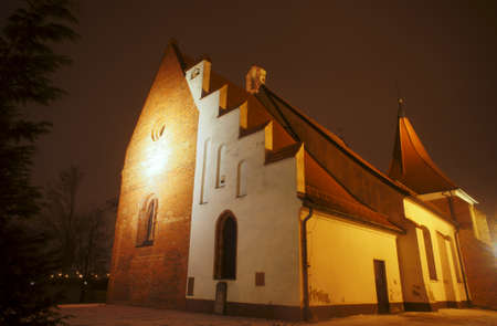 Gothic church of the Order in the night in Poznan photo
