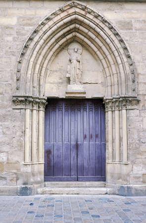 romanesque: Portal in romanesque church in Reims, France Stock Photo