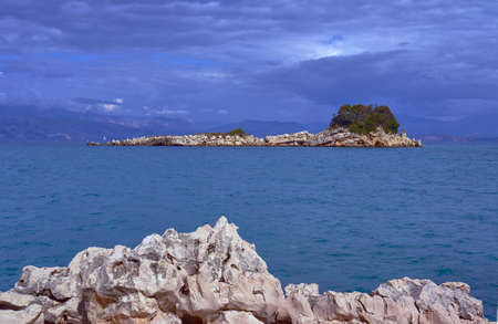 ionian island: Rocky island in the Ionian sea and the mountains in Albania