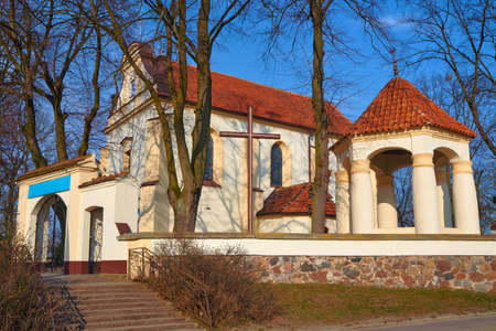 country church: Baroque country church with a bell tower in Poland Stock Photo