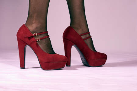 clasp feet: Red female shoes on a high wedge heel