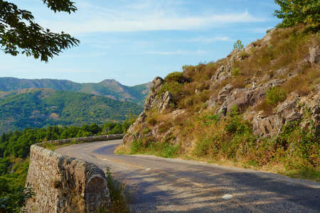massif: Asphalt road in the mountains of the Massif Central in France