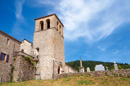 bell tower: Medieval church with a bell tower and cemetery in France