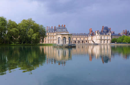 Park and Royal Residence in Fontainebleau, France Editorial