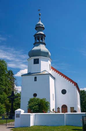 parish: Rural parish church with bell tower in Poland Stock Photo