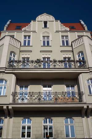 ade: Windows on the facade of the Art Nouveau building in Poznan