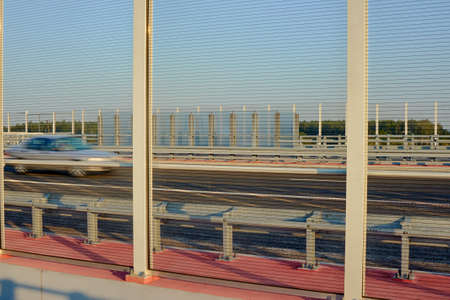 fast lane: Transparent noise barriers and moving vehicle on the road fast lane