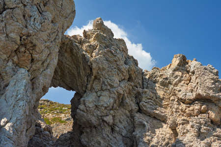 stone volcanic stones: rocky cliff on the island of Rhodes