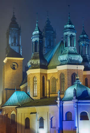 poznan: Towers of the Cathedral of Saints Peter and Paul in Poznan in the fog, Poland Stock Photo
