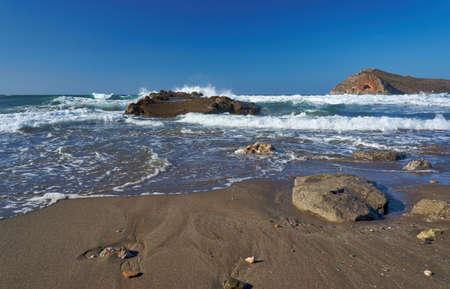 theodore: breakwater on beach and Theodore island, Crete, Greece