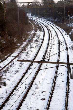 traction: Railroad track and electrical traction during the winter in Poznan