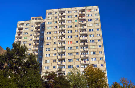 ade: The facade of a residential high-rise building in Poznan