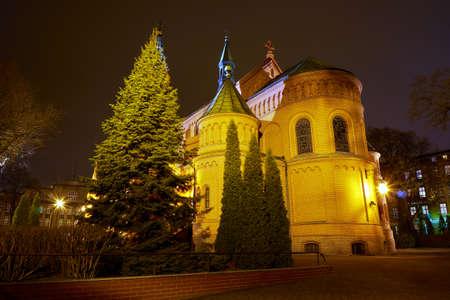 romanesque: Romanesque brick Catholic church at night in Poznan