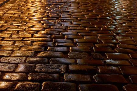 poznan: A wet cobbled street in the rain in Poznan