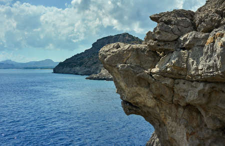 edge of cliff: rocky cliff at the edge of the Mediterranean Sea, on the island of Rhodes