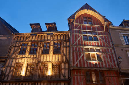 tenement: tenement houses in the old town of Troyes at night, France