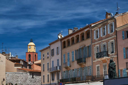 tropez: Tenement houses and church in the port of Saint-Tropez, France Stock Photo