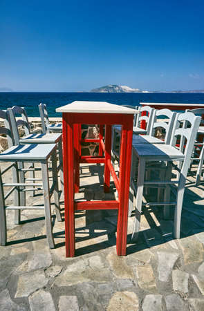 taverna: Table and chairs Greek taverna on the seafront on the island of Nisiros Stock Photo
