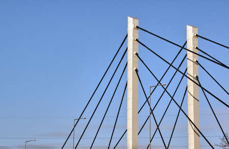 shroud: Cable-stayed bridge pylons and tree branches in Poznan Stock Photo