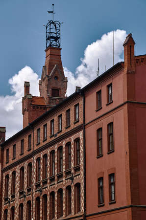turrets: The facade of red brick building in Poznan