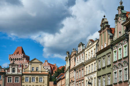 townhouses: Townhouses in the Old Market Square and the tower of the Royal Castle in Poznan