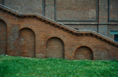 redbrick: Wall red-brick building with stairs in Poznan