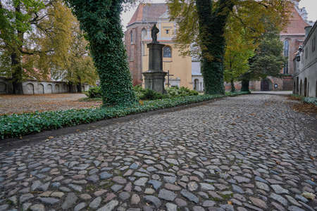 empedrado: Paved alley leading to the medieval church in Poznan