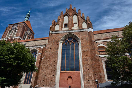 Gothic brick church with a bell tower in Gdansk