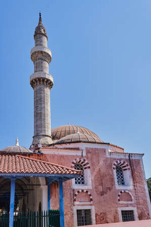 Turkish mosque with minaret in Rhodes, Greece Stock Photo