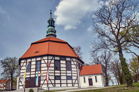 Tudor style country church with a bell tower in Poland Stock Photo
