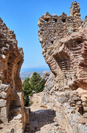 The ruins of the stone gate of the ancient city of Palio Pyli on the island of Kos in Greece