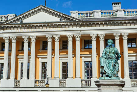 Sculpture of a woman against the background of the front facade of the public library of them. Raczynski in Poznan