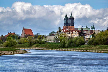 Urban landscape with river Warta and the cathedral towers in spring in Poznan Stock Photo