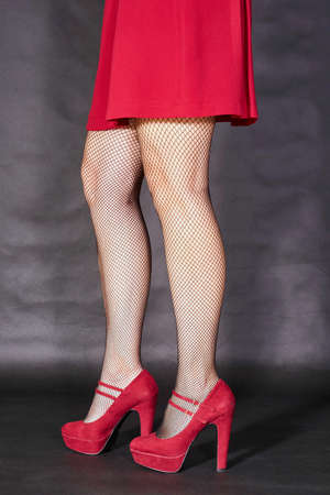 clasp feet: The slim legs of the girl in the red dress