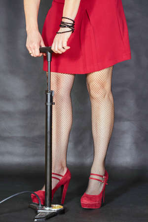 clasp feet: Elegant girl in red dress with car pump