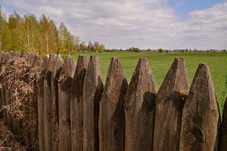 A rural landscape with a fragment of old paling in Poland Stock Photo
