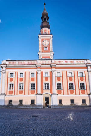 Baroque Town Hall with clock tower on the market in Leszno Stock Photo
