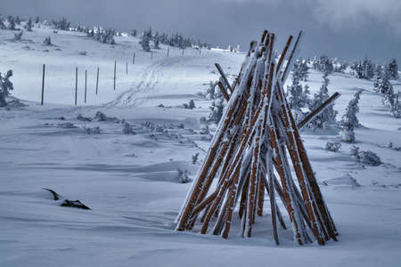 stakes: Stack of wooden stakes to mark the winter hiking trails in the Giant Mountains in Poland Stock Photo