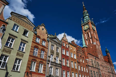 Facade historic tenement houses building and town hall in Gdansk Stock Photo