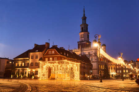 town hall with clock tower and christmas decorations in the city of Poznan