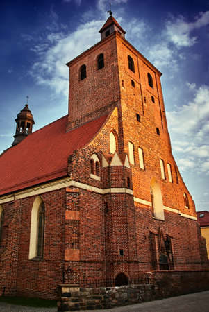 gothic medieval Catholic Church with belfry of in Grudziadz