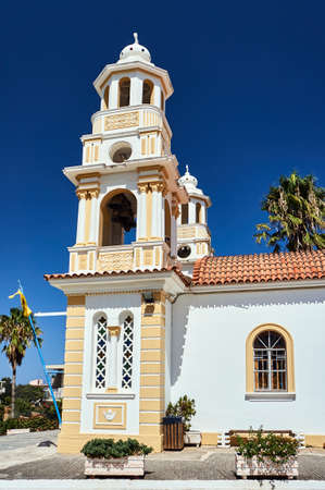 Orthodox church with belfry in greek town, Crete Stock Photo