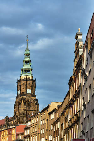 Houses and a gothic church with a clock in the city of Swidnica Banque d'images