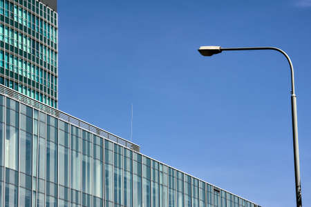 Street lamps and facade of modern buildings in Poznan