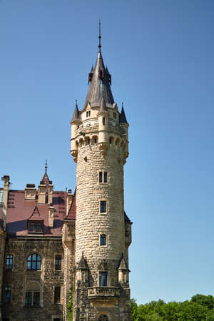 Neo-Gothic tower of the historic Moszna castle in Poland Editorial